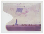 Boy walking in front of fading mural of American flag in Seligman, Arizona.