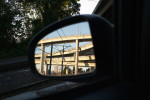 Reflection of overpasses in side mirror of a car in Portland, Oregon.