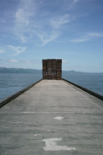Stack of pallets at the end of a dock in Astoria, Oregon.